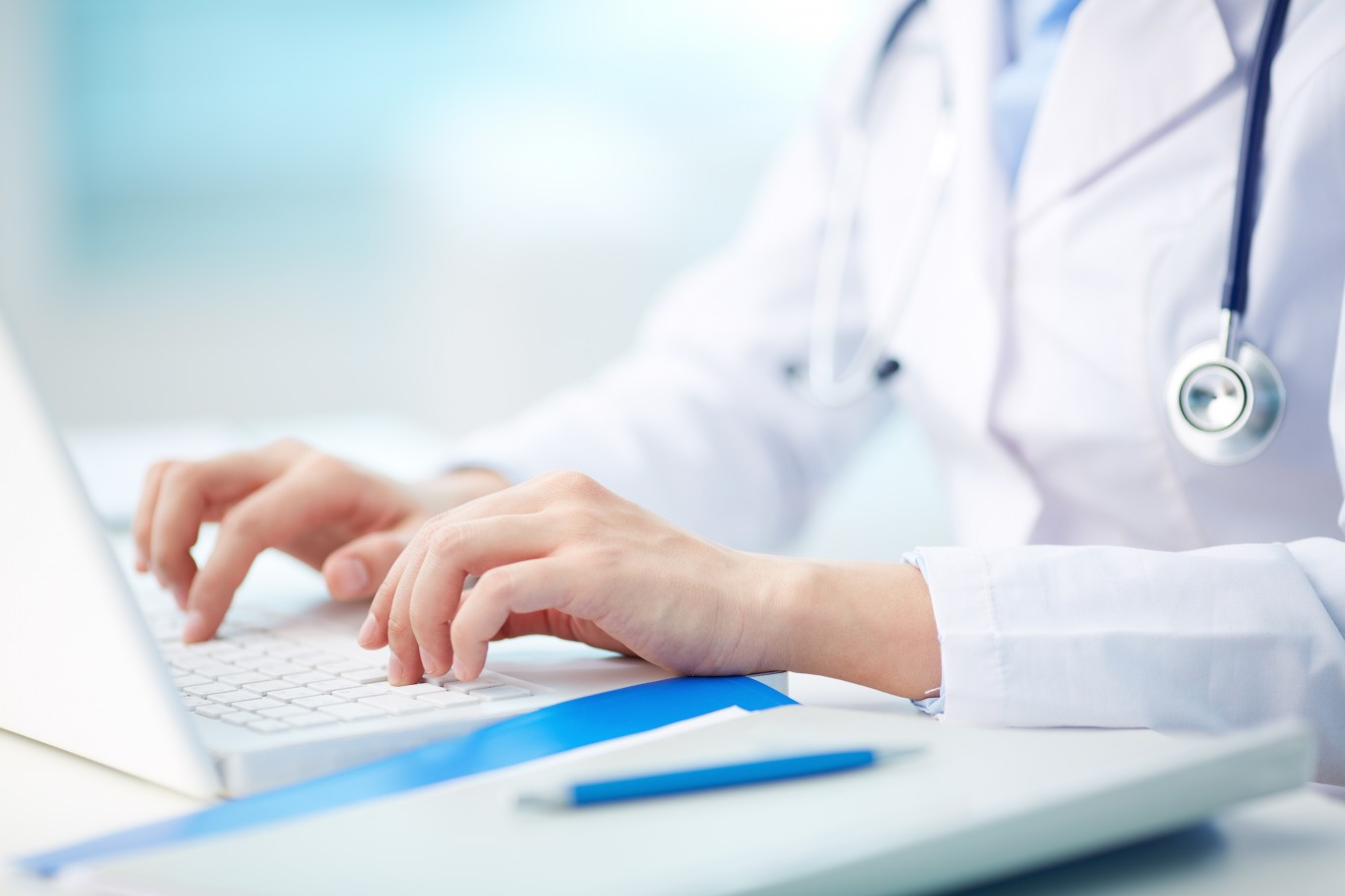 20258980 - close-up of a medical worker typing on laptop