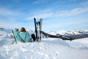 17801711 - couple of skiers relaxing in long chairs