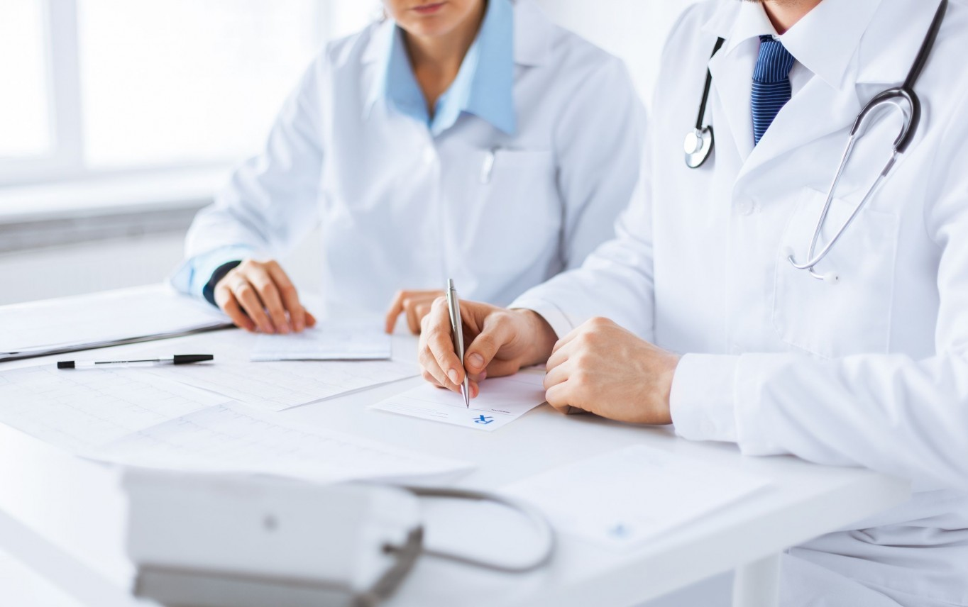 20859738 - picture of doctor and nurse writing prescription paper