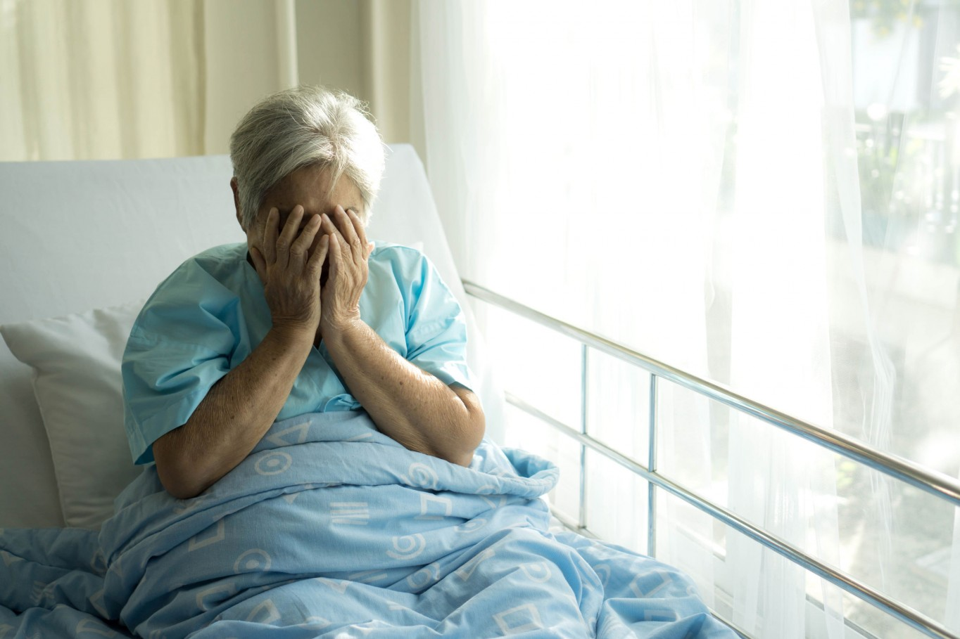 Lonely Elderly patients in hospital bed patients want to go home - medical and healthcare concept