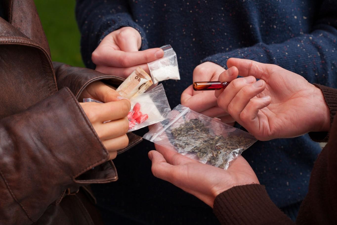 Drug dealer selling pills,marijuana and cocaine